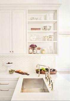 Gorgeous white kitchen with herringbone backsplash