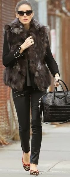 Feathery ladies warm sleeveless jacket, black jeans, shirt , black bag and leopard flatted shoes