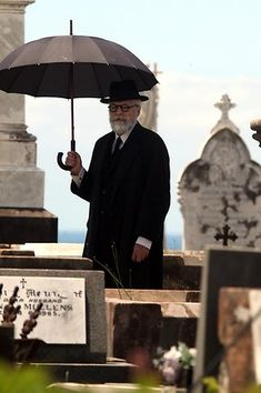 """A photo of the """"Owl Man"""" at the funeral of Jay Gatsby, a scene cut from the film."""