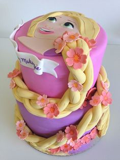 Rapunzel Cake  Would do some cutting with a fondant knife to make it look like hair in the braid first then braid the fondant.