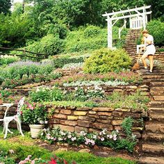 hillside landscaping ideas. Reminds me of the little house we lived in when I was little my favorite place.