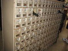 old post office boxes used as wine rack -- something very cool about this