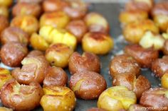 Ruby and Golden Mini Potatoes cooked in chicken broth, then smashed and cooked on the grill with butter, and coarse salt. Absolutely delicio...