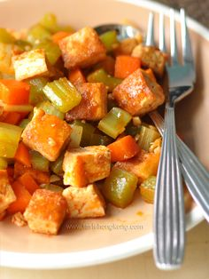 EASY TOFU STIR FRY = ~300g firm tofu 4 celery stems 1/2 carrot 3 cloves garlic, coarsely chopped 1-2 tbsp cooking oil (I used coconut oil) Seasonings 2 tsp chili sauce, I used Korean type 1 1/2 tsp soy sauce 1/2 tsp sugar 4 tbsp water 1/4-1/2 tsp sea salt===