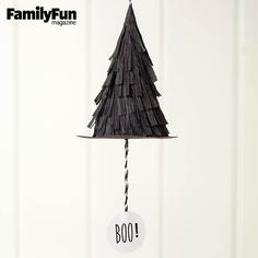 Witch-Topper Poppers: Packing the punch of pinatas without the mess and tears, these spellbinding little hats spill goodies when the tags are pulled. Display them on hooks or a branch. When it's time to pop them, take each hat down, then hold the cone in one hand while pulling the string with the other.