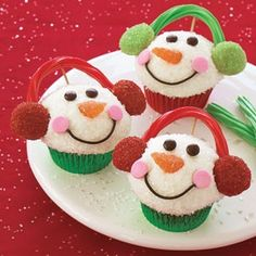 Snowman Cupcakes and many other Recipes for Christmas sweets.    Ingredients:    12 cupcakes, baked in colored foil liners, cooled  1/4 cup each red and green decorating sugar  24 mini vanilla wafers  1 can (16 oz.) vanilla frosting  4 orange fruit slices  1/4 cup dark chocolate frosting  1 cup white decorating sugar  6 each red and green licorice