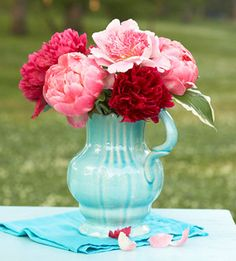 A passion for peonies! This arrangement shows off the varieties 'Do Tell', 'Coral Charm' and 'Diana Parks'. Read our peony growing tips: http://www.midwestliving.com/garden/flowers/peony-how-to-grow/
