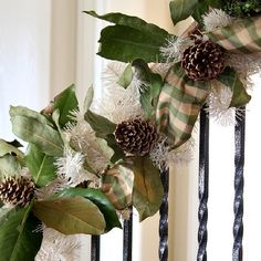 Learn how to make a staircase Christmas garland with magnolia boughs and gilded pinecones and buffalo check ribbon.
