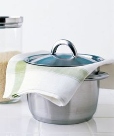 **Tried this...it works!  Steam perfect rice. Once the rice is tender, remove the pan from the heat, place a folded towel over the saucepan, replace the lid, and set aside for 5 to 10 minutes. The towel will absorb the excess moisture for great rice with no mush.