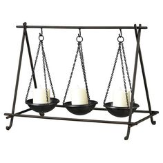 Steel candleholder with three hanging bowls.  Product: CandleholderConstruction Material: MetalColor: