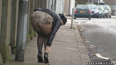 Sexy pantyhose public upskirt big butt British milf in arse revealing skirt and seamed fishnet pantyhose tights flashing her big ass in street.
