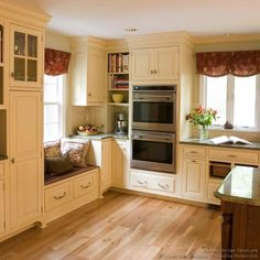 #Kitchen Idea of the Day: Love the country cottage flavor of this traditional off-white kitchen. (By Crown Point Cabinetry)