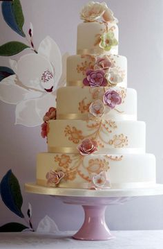 Pretty Gold Piping & Flowers Tiered Cake Photo