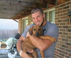 Tim Tebow and a hound pup. too adorable.