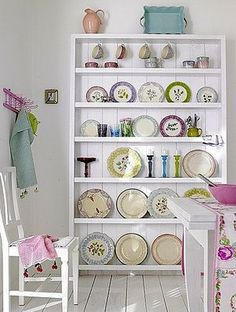 "cute and colorful plate display taking up about 4"" of depth on the wall"