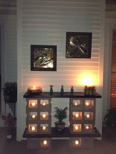 outdoor table made from cinder blocks and stained pine wood. nice ambience using the votive candles #DIY shelves + cinder block