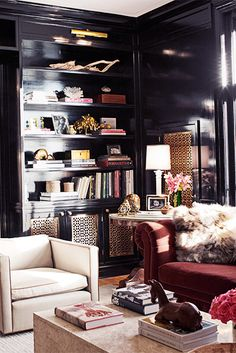 Everything You Need For a Skillfully Styled Bookshelf // bookcase, bookshelves, brass table lamp, black walls