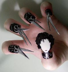 Edward Scissorhands nails. Yep, we've now officially seen everything.