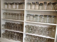 a cupboard stocked with vintage canning jars for sale