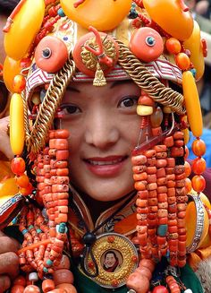 Tibetan lady modelling an incredibly expensive and heavy ceremonial costume during the King Gesar Arts Festival / Khampa arts festival in the Kham region of Tibet in 2004. | © BetterWorld2010
