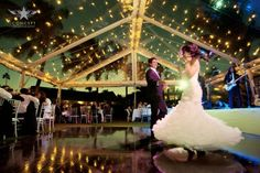 There's nothing like a clear tent under the palm trees & stars with cafe lighting! This destination wedding is at South Seas Island Resort on Captiva Island, Florida. Photo Credit to: Concept Photography Planning & Design by KellyMcWilliams' Weddings by Socialites www.WeddingsbySocialites.com