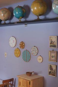 Our playroom. Vintage Globes plus a Waldorf play kitchen plus fun fabrics. I had to share with you, @Meg McElwee.