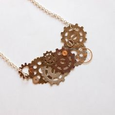 DIY Steampunk Gears Necklace: You won't find this in stores - Make your own! Now I know what to do with my tiny watch parts!