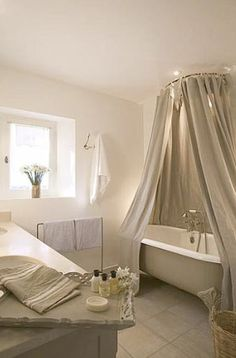 canopied clawfoot tub - LOVE the romance of this ... I think I'd choose slightly different paint colors, but this is nice  ********************************************  SancturaryHome #canopy #clawfoot #tub #bathroom