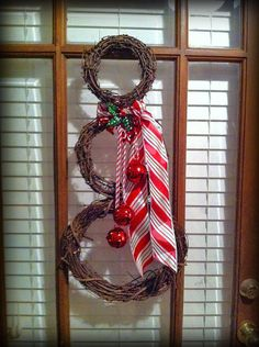 "Grapevine Snowman Door Wreath: Basically you just attach the the 3 wreaths together using the wire.  Make sure you include the bells between the first and second wreath and use the wire to put all 3 pieces together. Once that is done, cut the ribbon to the length that you want and tie it around the ""neck"" of the snowman like you would a scarf. Easy breezy."