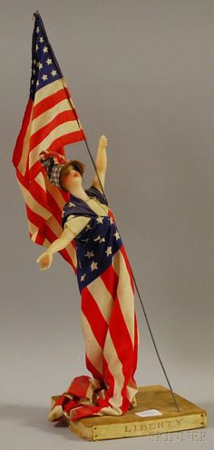 "Sarah Bernhardt Autographed ""Liberty"" Wax Doll Wearing an American Flag Dress, Scarf, and Holding an American Flag."
