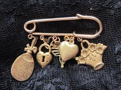 Vintage Brass Safety Pin Brooch With Six Charms