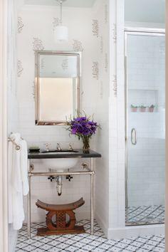 Interior Design by Anna Hackathorn, bathroom, powder room, guest bath, gray and white wallpaper, les indiennes, glass shower door, black counter top, ann saks tile, african stool, wood stool, www.annahackathorn.com