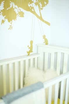 Love this sweet tree swing detail to set off a neutral wall #nursery