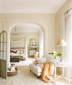 white paneling in the sitting room and bedroom