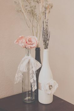 DIY Wedding Centerpieces with roses, lavender, wheat and baby's breath. Re-use old wine bottles and decorate with lace and ribbon.