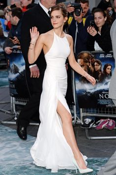 Emma Watson in custom Ralph Lauren Collection dress, rose-gold Jennifer Fisher cuffs, and white Jimmy Choos