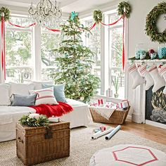 Love the ribbon and bay leaf wreaths in this pretty Christmas living room