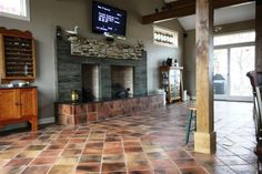 This rustic flooring is mastered by installing a 12x12 size Antique Saltillo tile.  Note the terra cotta color variations that can be brought out with unique decor.  Kudos to Rustico Tile and Stone for this production!