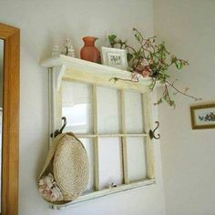 Old windows are popular on the wall, but they can be functional too with a shelf and hooks! This looks great on the wall! ReHouse has hundreds of salvaged windows from old homes and buildings available for a project like this! www.rehouseny.com diy ideas, decor, old window frames, project, craft, hooks, shelves, old windows, hous