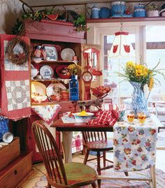 Country style dining room.  Love the red cabinet !
