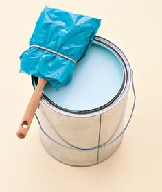 A supermarket bag, tightly secured with a rubber band, will keep a brush (or roller) moist for a day or two in between painting sessions: the end of dried-out bristles.