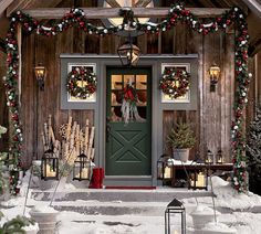 Pottery barn, of course. but what a delightful design for a barn home or cabin. or even your home. simple, statement it really works. holiday, cabin, christmas decorations, front doors, country christmas, rustic christmas, outdoor christmas, christmas porch, front porches