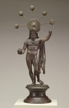 """Sucellus Walters Art Museum description:  """"Sucellus was a major Gaulish deity associated with the underworld, whose attributes include his wolf-skin garment, a mallet or hammer (now missing from his upraised hand), and a small jar called an """"olla."""" ... Behind him, like a symbol of worship, appears an oversized mallet with five smaller mallets radiating from it. The statuette was excavated from the """"lararium"""" (household shrine) of a Roman house in France."""""""