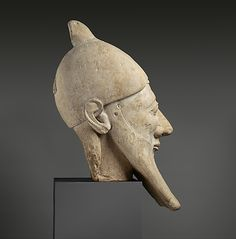 Limestone head of a bearded man  Period:     Archaic Date:     early 6th century B.C. Culture:     Cypriot Medium:     Limestone