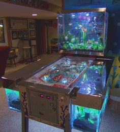 Tanked - pinball tank. This would be awesome. Not sure how cleaning it would go.