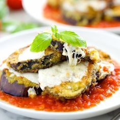 The Secret to the Best Eggplant Parmesan with a crispy coating yielding to a creamy interior, topped with melty cheese and fresh basil!