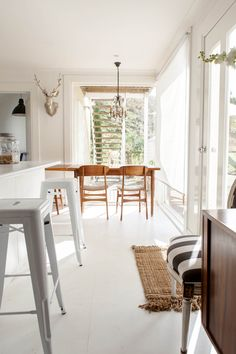 interior, antler, black white, danish, deer heads, kitchen counters, bar stools, homes, white kitchens