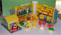 Fisher Price Dollhouse- I played with this for hours upon hours. I loved the kitchen.