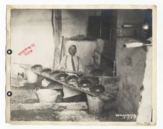 Portrait of a baker removing freshly baked loaves of bread from an oven at the bakery of the Central Relief Committee for Jewish Refugees from the Ukraine and Russia. Volomin, 1921-22.