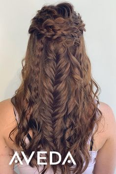 Michelle at @avalonfredericton is the talented Aveda Artist behind this romantic boho updo with braids. Follow this board for more ideas for wedding and prom updos and hairstyles, tap the photo to see our Aveda How-To Tutorial Video Library for DIY hairstyles for long, short and medium length hair.